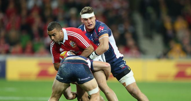 Lachlan Mitchell tackles Simon Zebo during the Rebels' game against the Lions