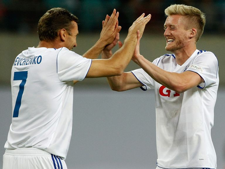Andre Schurrle: Celebrates with Shevchenko at the Ballack farewell match