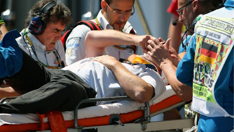 Paul Allen is stretchered away after being hit by Mark Webber's tyre