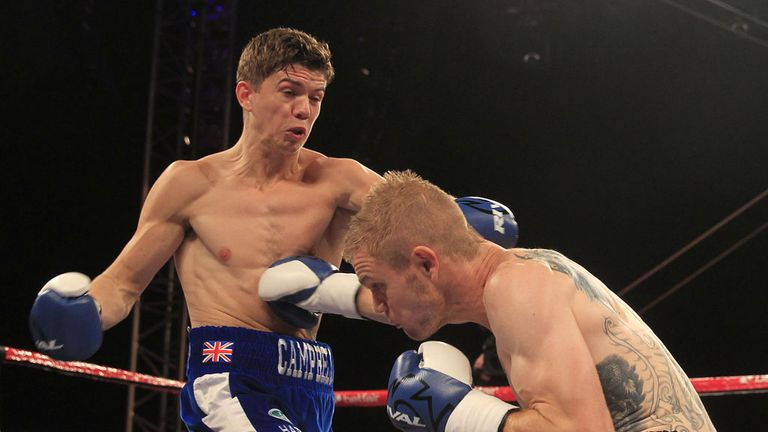 Luke Campbell (L) lets the right hand go as Harris looks to land a shot (Pic Lawrence Lustig)
