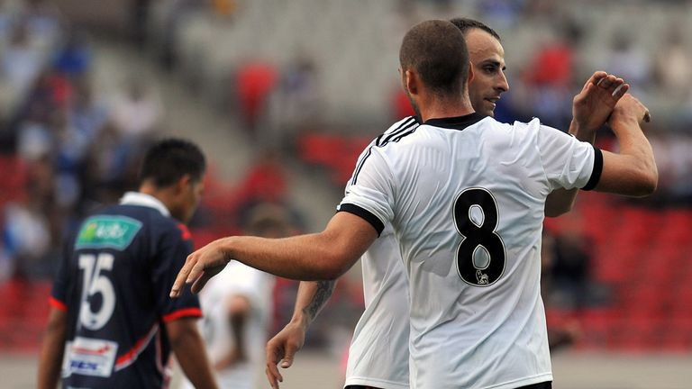 Dimitar Berbatov: Celebrates with Patjim Kasami in San Jose