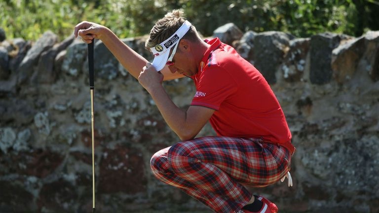 Ian Poulter can't bear to look as he ponders another quick putt at Muirfield