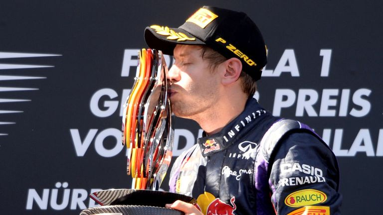 Vettel celebrates his first victory of his home race