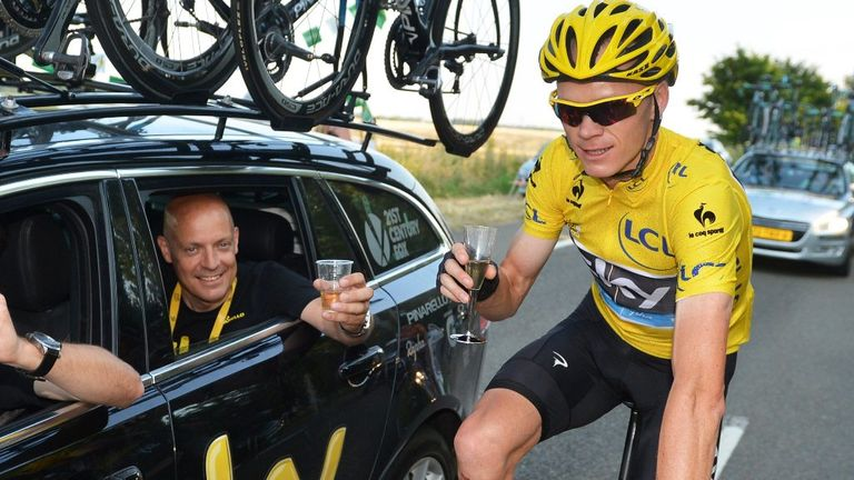 Celebrate: Froome enjoys a sip of champagne with Dave Brailsford