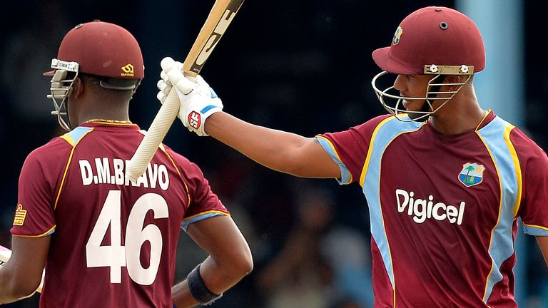 Lendl Simmons raises his bat during the recent Tri-Nations series while batting with Windies skipper Dwayne Bravo