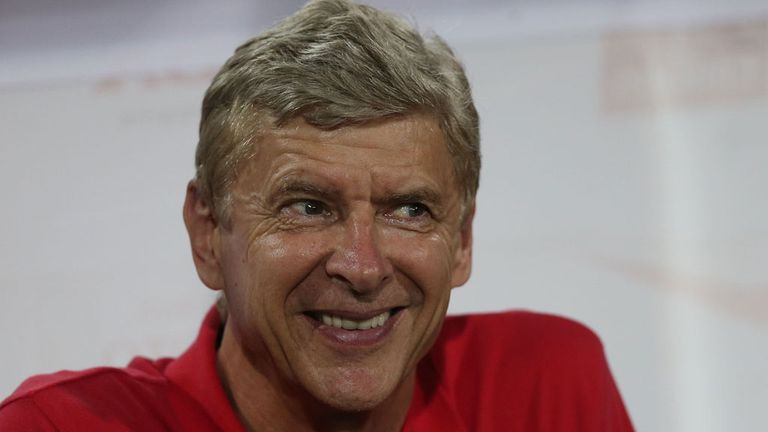 Arsene Wenger: Arsenal boss is all smiles in the heat of Hanoi