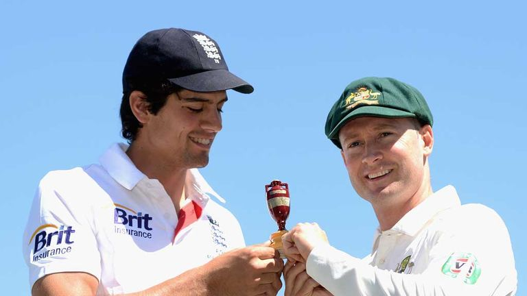 Michael Clarke (right) with England skipper Alastair Cook and Ashes urn