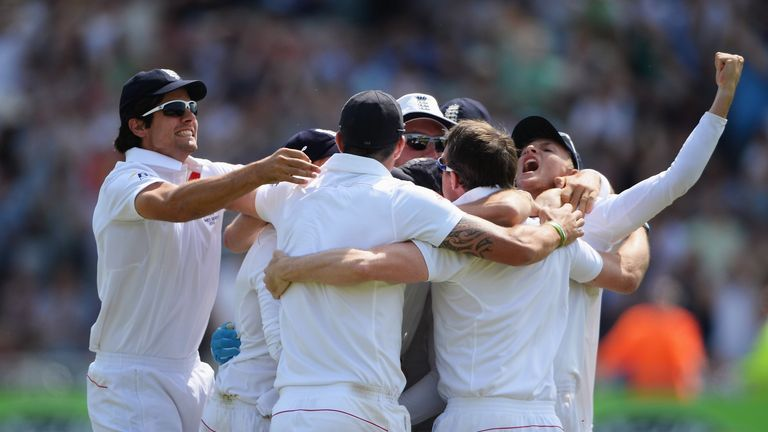 Captain Alastair Cook (L) and the England team celebrate this summer's Ashes victory