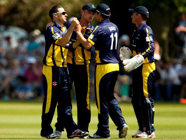 Nathan McCullum of Glamorgan celebrates with his team-mates.