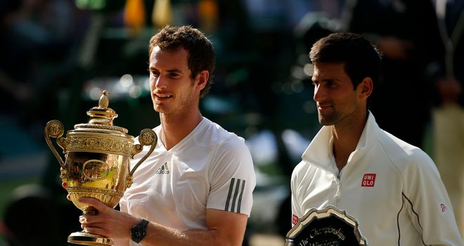 Andy Murray receives his trophy at Wimbledon