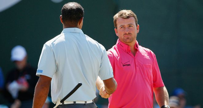 Graeme McDowell congratulates Tiger Woods at the end of the second round