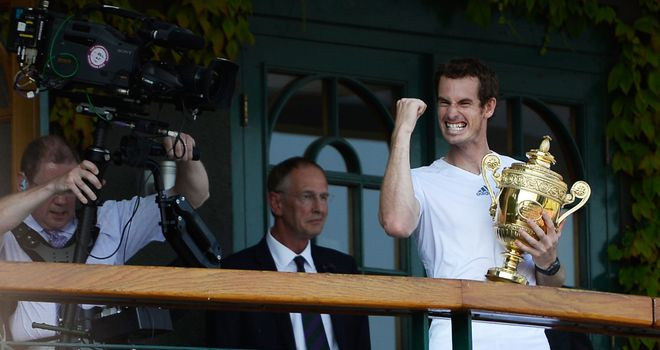 Andy Murray celebrates with the Wimbledon trophy after winning the title in 2013