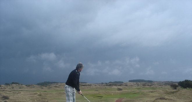 Matt prepares to tee off under darkening skies