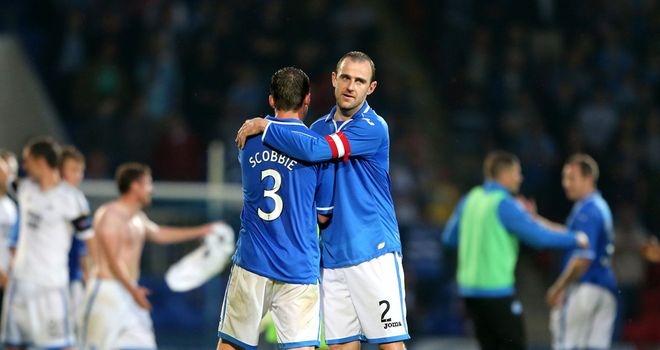 St Johnstone's Dave Mackay and Tam Scobbie celebrate at the final whistle
