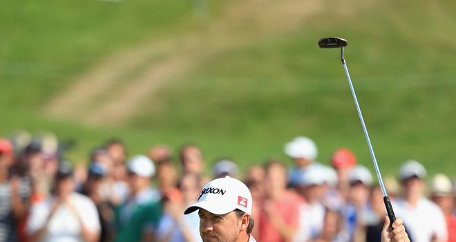 Graeme McDowell: Celebrates victory on the 18th green at Le Golf National