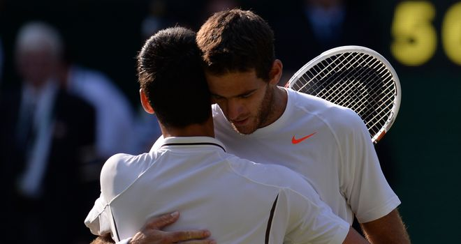 Novak Djokovic embraces beaten opponent Juan Martin del Potro after their thrilling semi-final