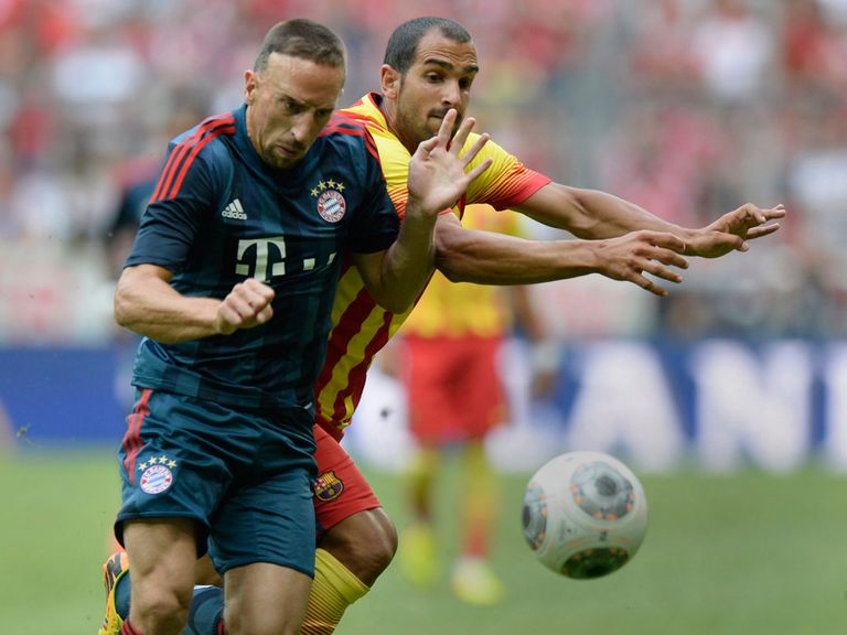Franck Ribery and Martin Montoya battle for possession