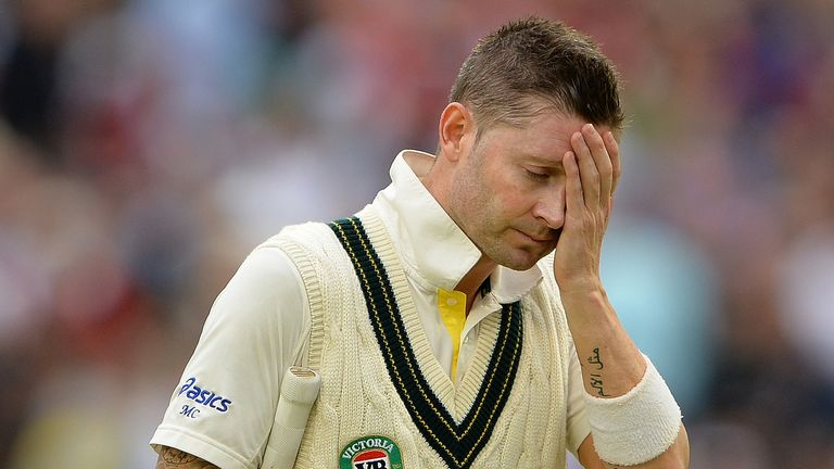Michael Clarke sees the writing on the wall as he heads off due to bad light