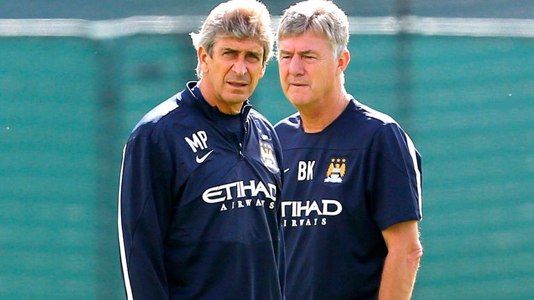 Brian Kidd (r): Man City No.2 delighted that Manuel Pellegrini landed his first trophy