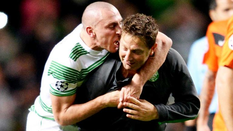 Scott Brown: Celebrates with Celtic coach Garry Parker