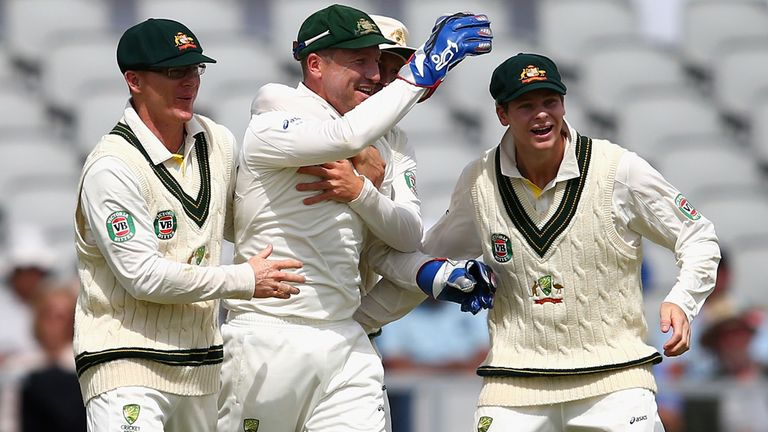 Brad Haddin (C) celebrates taking the catch that removed England captain Alastair Cook