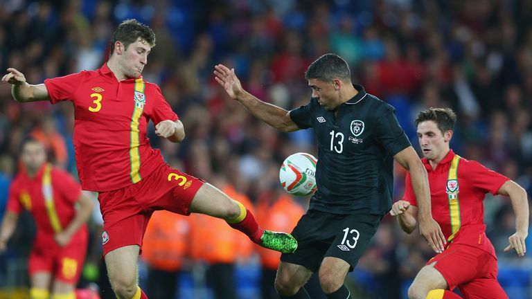 Republic of Ireland striker Jonathan Walters is challenged by Ben Davies