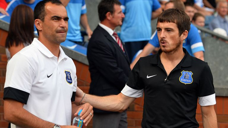 Roberto Martinez (left) wants to keep Baines (right) and Fellaini