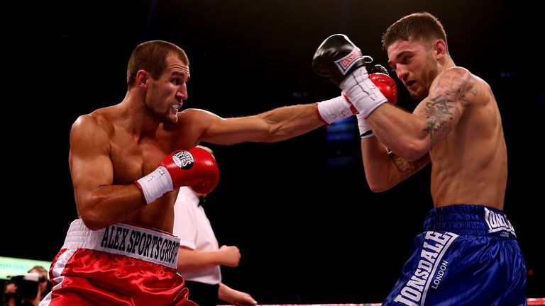 Sergey Kovalev (left) lands a punch on Nathan Cleverly in their WBO world light-heavyweight clash
