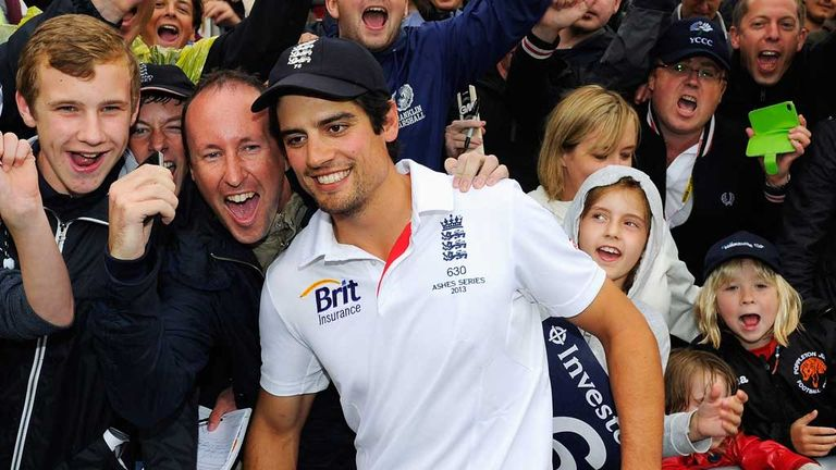 Alastair Cook celebrates with England fans at Old Trafford after Ashes are retained