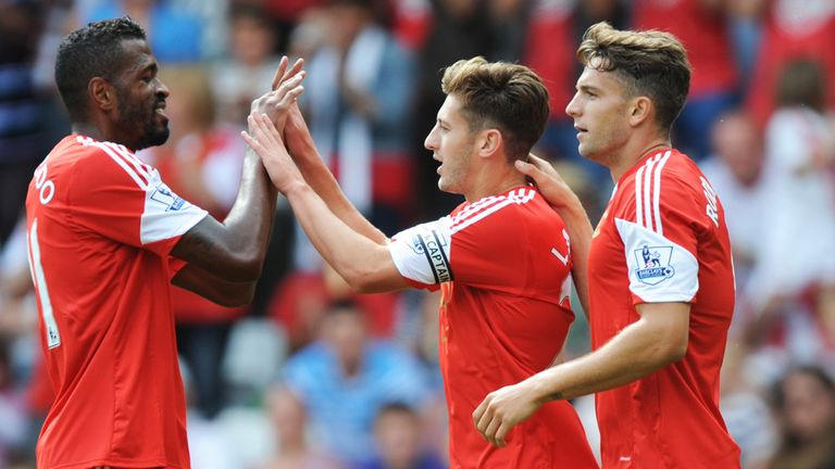 Adam Lallana celebrates with his Saints teammates