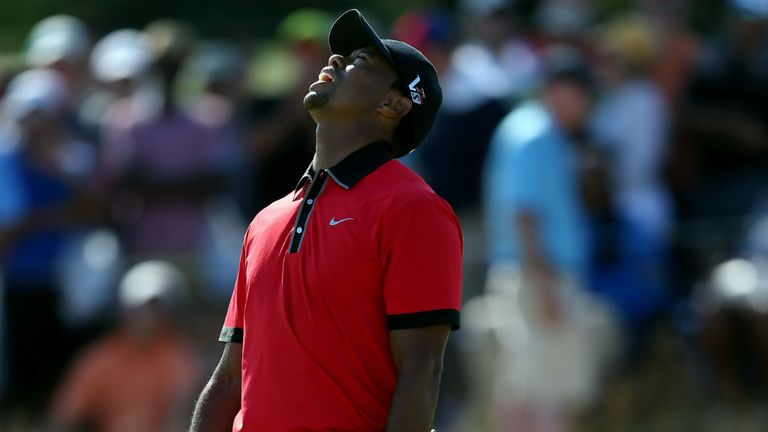 Tiger Woods reacts after missing a putt on the 12th hole during the final round of The Barclays