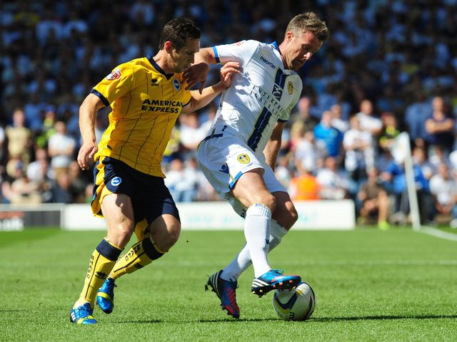 Andrew Crofts and Michael Tonge battle for the ball.