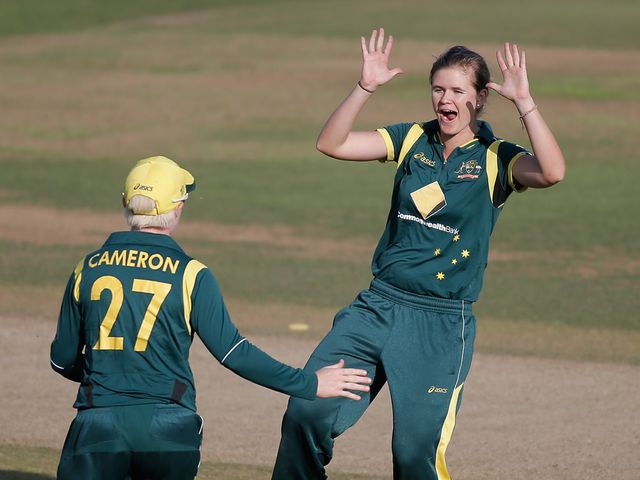 Jess Jonassen (r) celebrates one of her four wickets