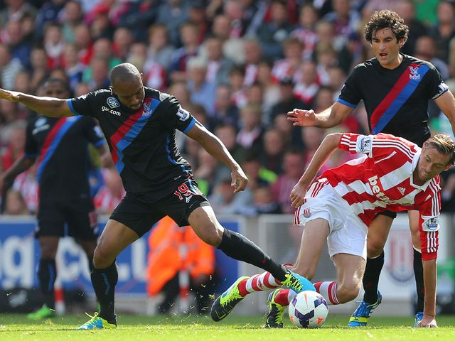 Gabbidon and Crouch keep focus on the ball.
