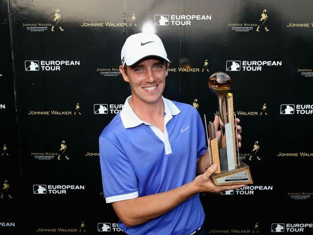 Tommy Fleetwood celebrates with the trophy.