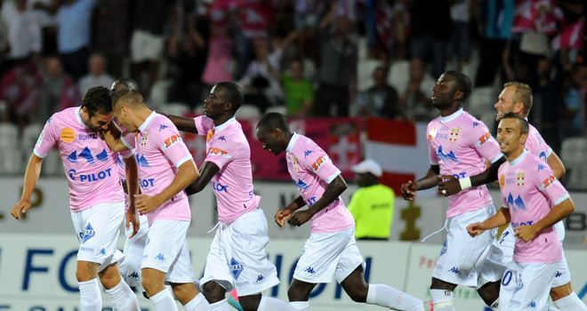 Evian's Swiss defender Fabrice Ehret is congratulated by his teammates