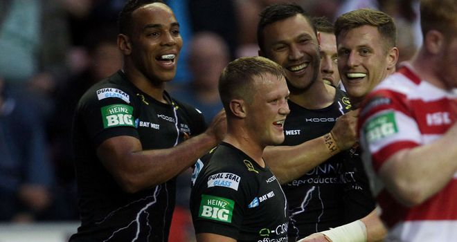 Huddersfield celebrate a try in their win over Wigan