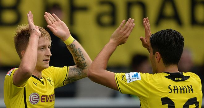 Marco Reus celebrates his successful penalty