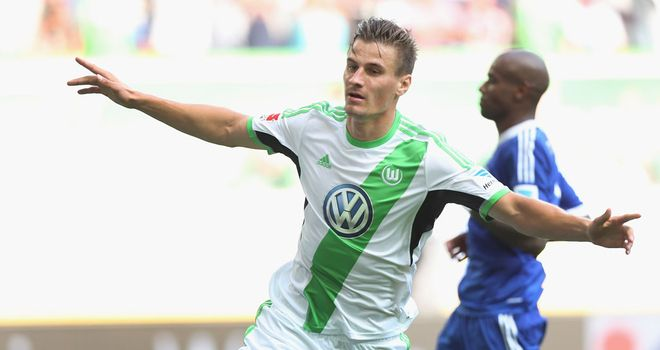 Stefan Kutschke celebrates his goal for Wolfsburg