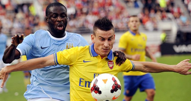 Laurent Koscielny shields the ball from Yaya Toure in Helsinki