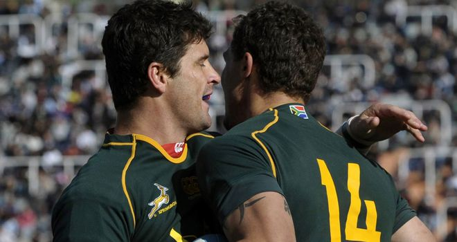 Morne Steyn celebrates with try-scorer Bjorn Basson (R)