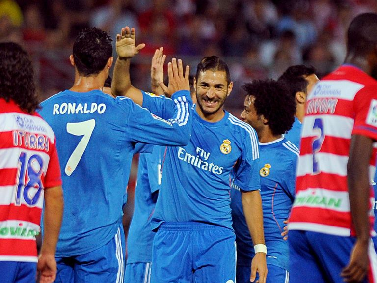 Benzema celebrates his winning goal with Ronaldo