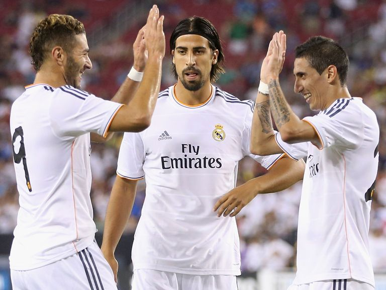 Karim Benzema celebrates with Sami Khedira and Angel Di Maria