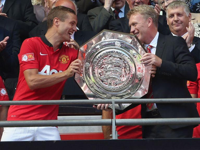 Nemanja Vidic hands the Community Shield to David Moyes.