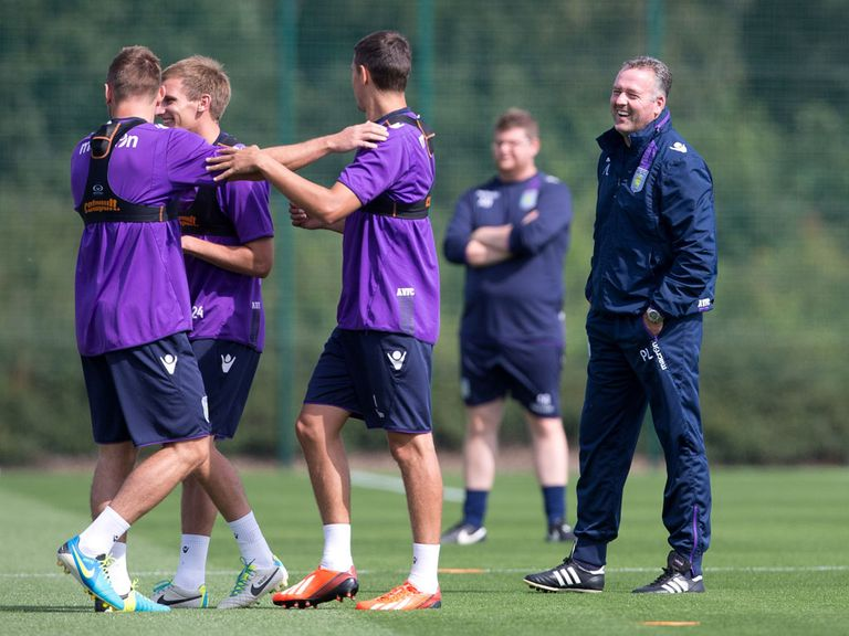 Lambert watches his Villa players train on Tuesday
