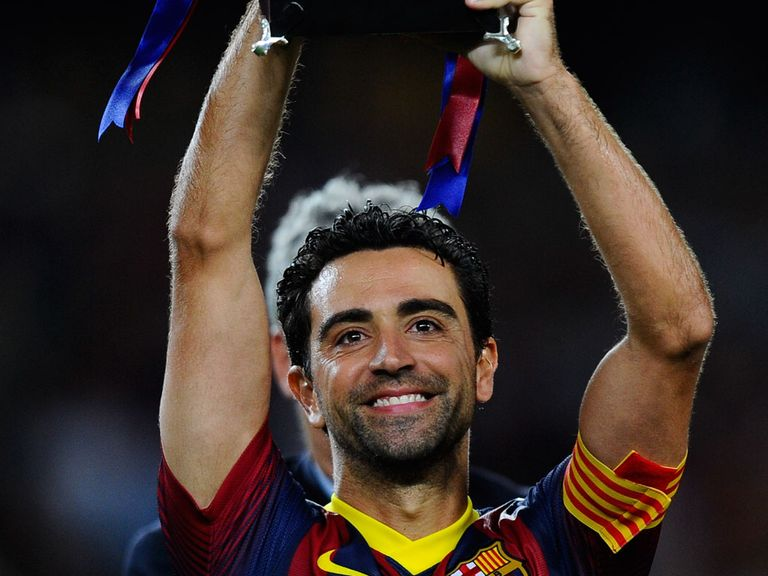 Xavi Hernandez holds the trophy aloft