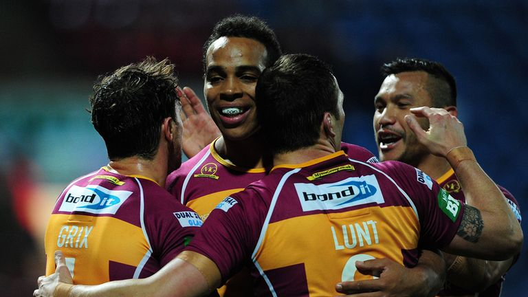 Scott Grix celebrates a try with his Huddersfield team mates