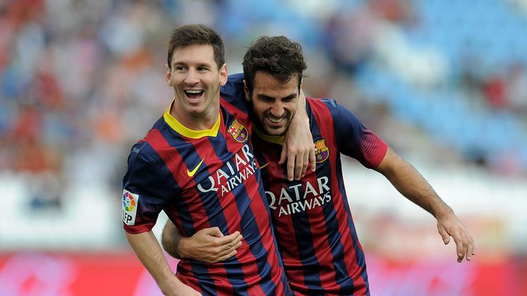 Lionel Messi celebrates another Barcelona goal with Fabregas before his injury