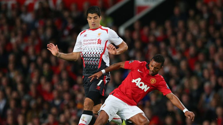 Luis Suarez: Is tackled by Nani on his Liverpool comeback