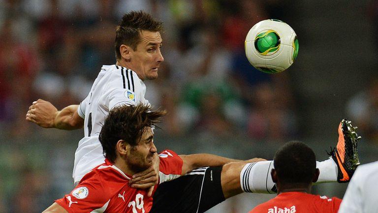 Miroslav Klose wins an aerial battle